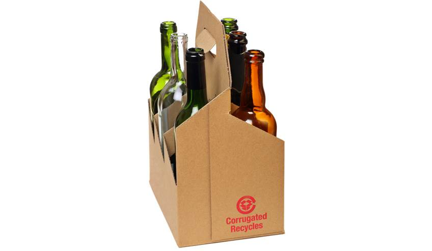 corrugated cardboard bottle carrier with empty glass bottles