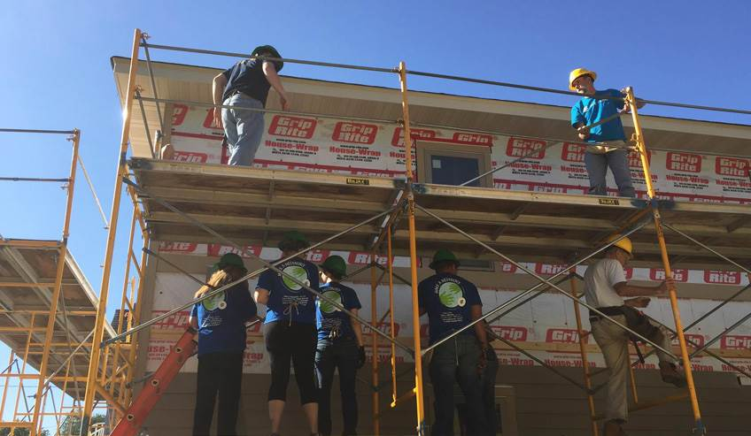 Group of H.B. Fuller employees working on a house for Habitat for Humanity.