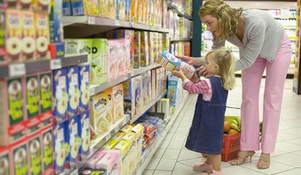 Woman and child shopping in a grocery store.