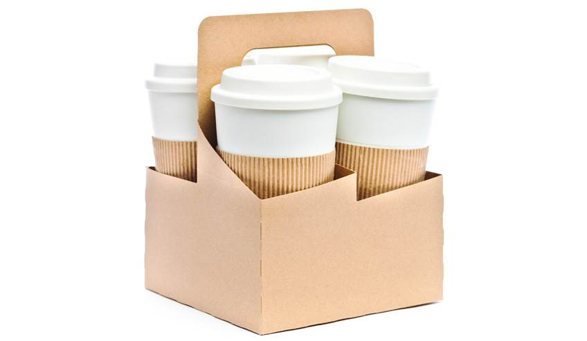 Cardboard cup holder with disposable coffee cups.