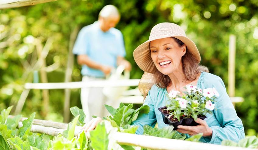 Older woman gardening and being active.