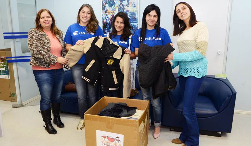 Group of woman donating coats for H.B. Fuller's make a difference day in Colombia.