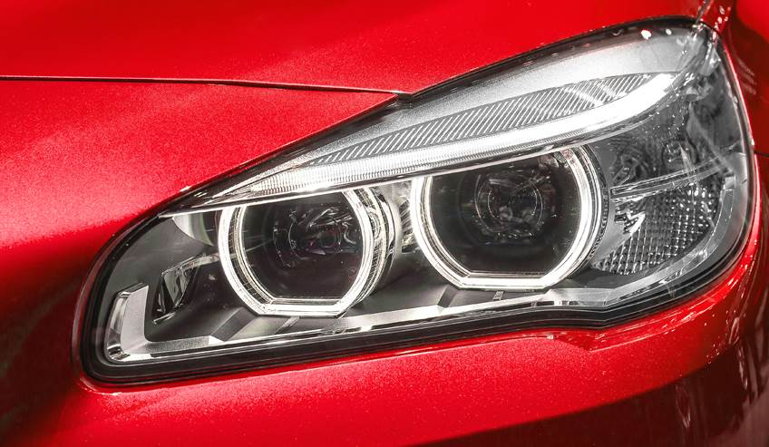 Headlight on a red car.