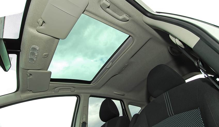 View of a sunroof in an automobile from the inside.