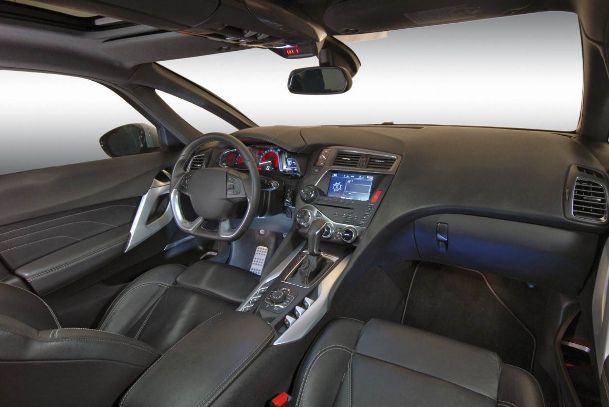 Interior of a car front seat and dash.