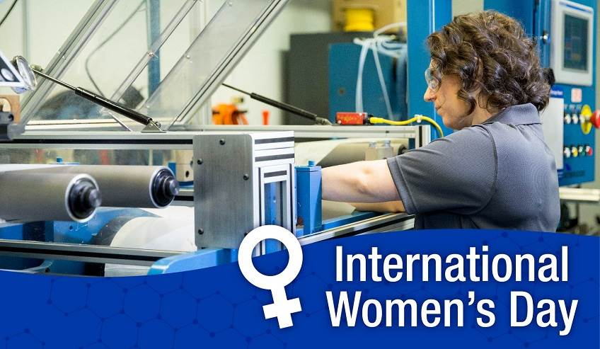 Scientist working on a machine representing International Women's Day.
