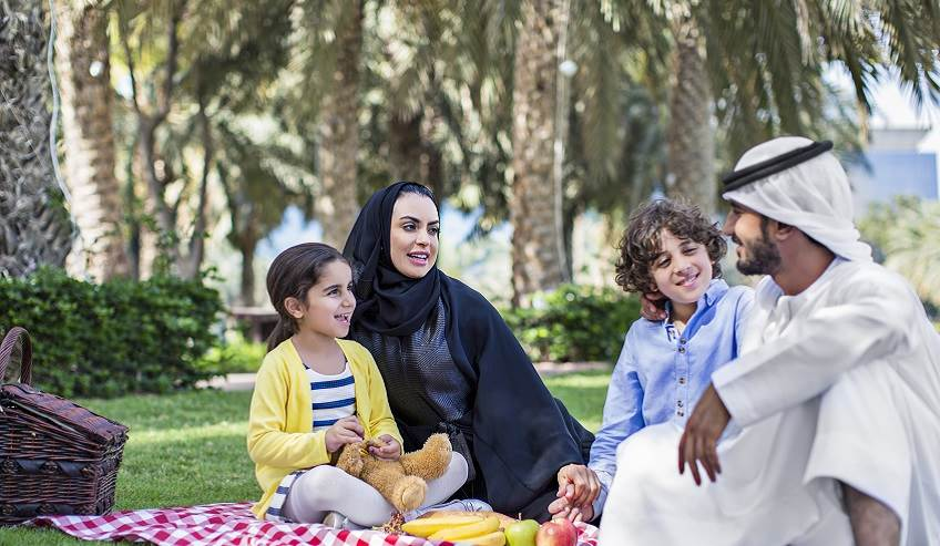 A family from UAE enjoy an outdoor picnic.