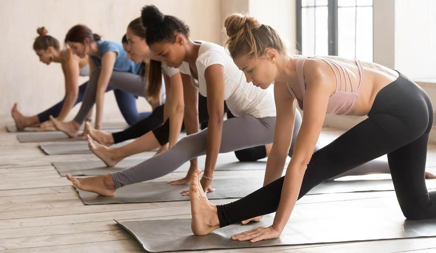 Women stretching in Yoga class.