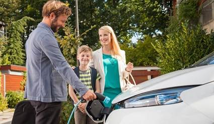 Family with an electric vehicle.