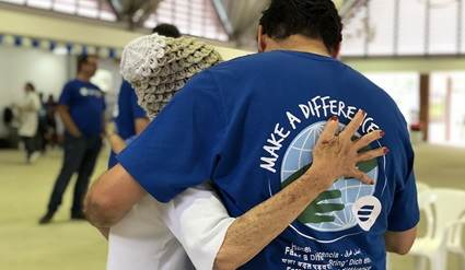 Volunteer hugging an H.B. Fuller employee after a volunteer group.