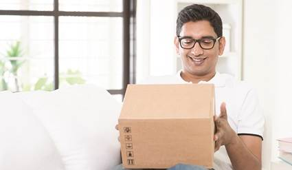 Man holding an e-commerce package.