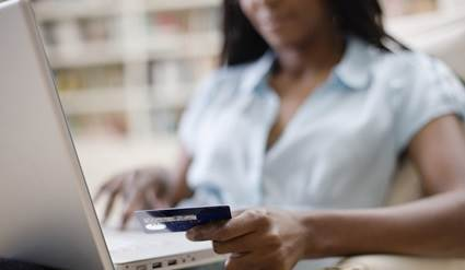 Woman shopping online with payment