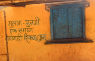 Gender equality message painted on house in India