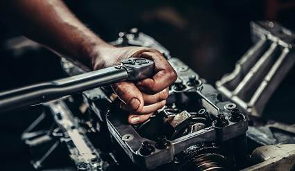Person working on a car engine.