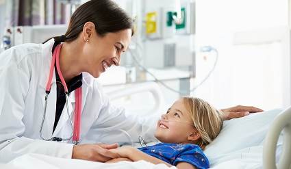 Doctor and child patient in hospital