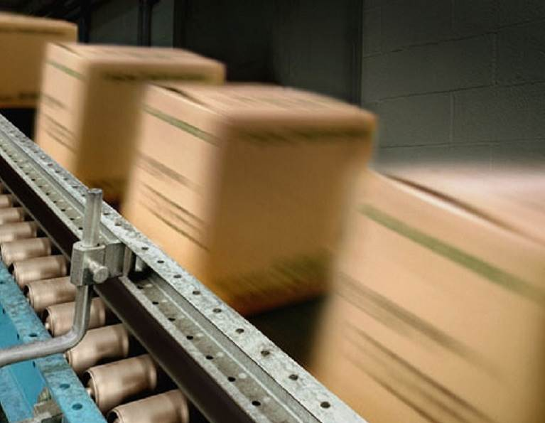 Case and cartons on a conveyor belt constructed using Advantra packaging adhesive from H.B. Fuller.
