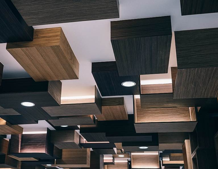 Many wooden box lights hanging from the ceiling.