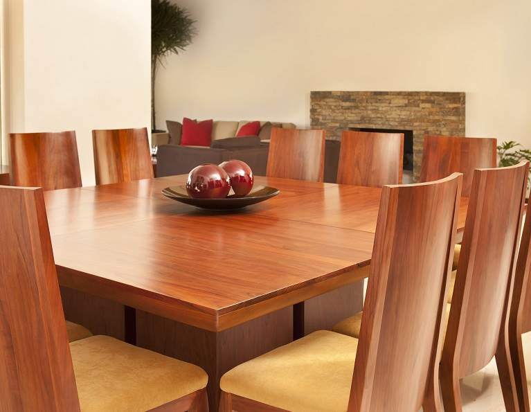 Large wooden kitchen table with wooden chairs.
