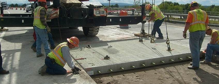 Construction workers installing concrete.