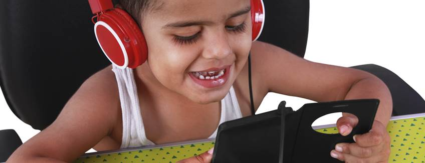 Little kid with headphones and cell phone case manufactured with H.B. Fuller electronics adhesives.