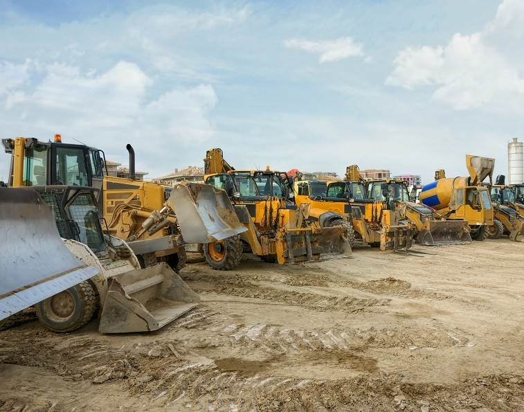 Lineup of heavy machinery dozers.