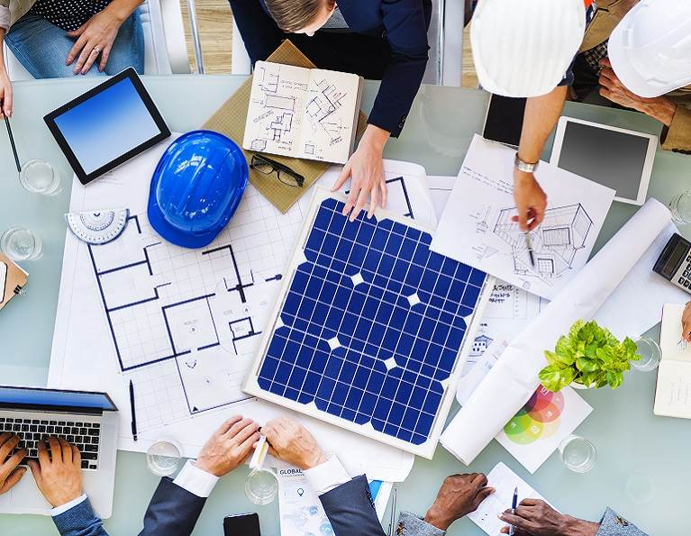 Group of architects designing solar panels