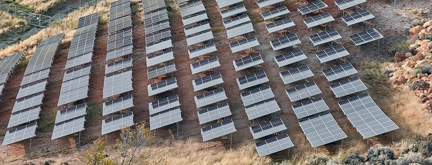 Solar panels on a hillside representing PV rail bonding adhesive solutions from H.B. Fuller.