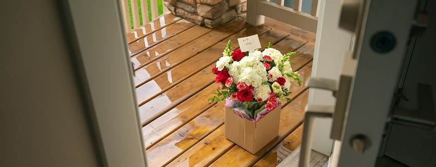 Moisture resistant packaging for floral delivery