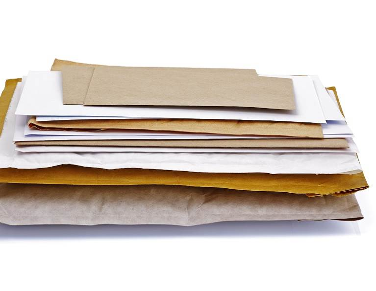 Stack of envelopes containing adhesive solutions from H.B. Fuller.