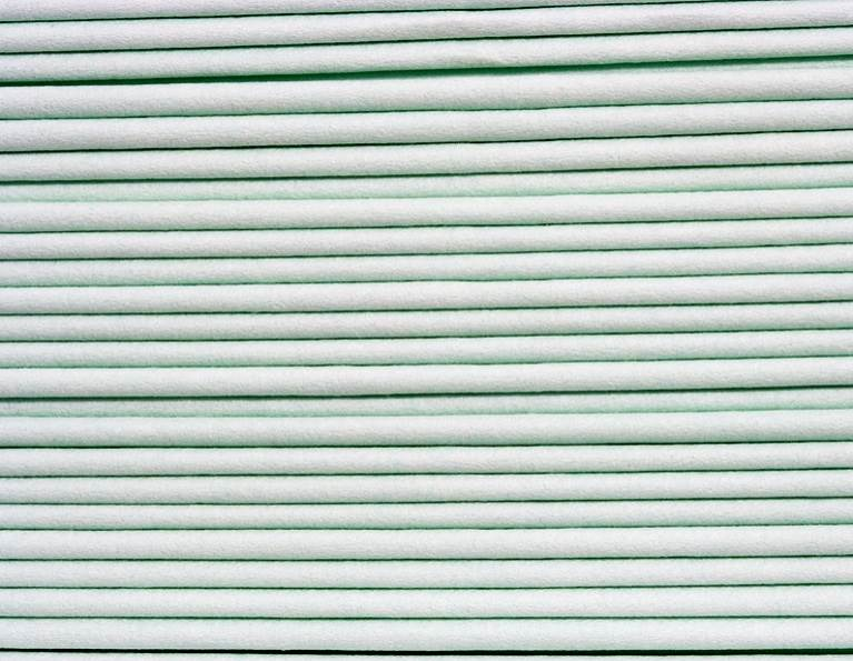 Stack of nonwoven product made with polymers.