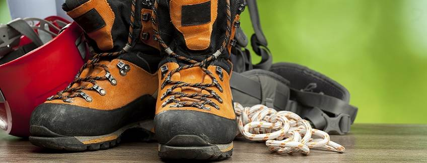 Hiking shoes representing sole preparation adhesives.