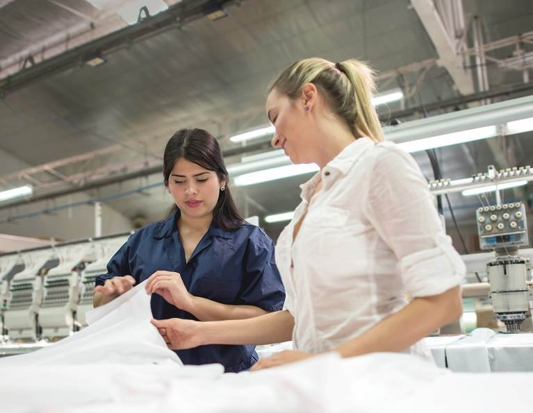 Two women in a textile factory.