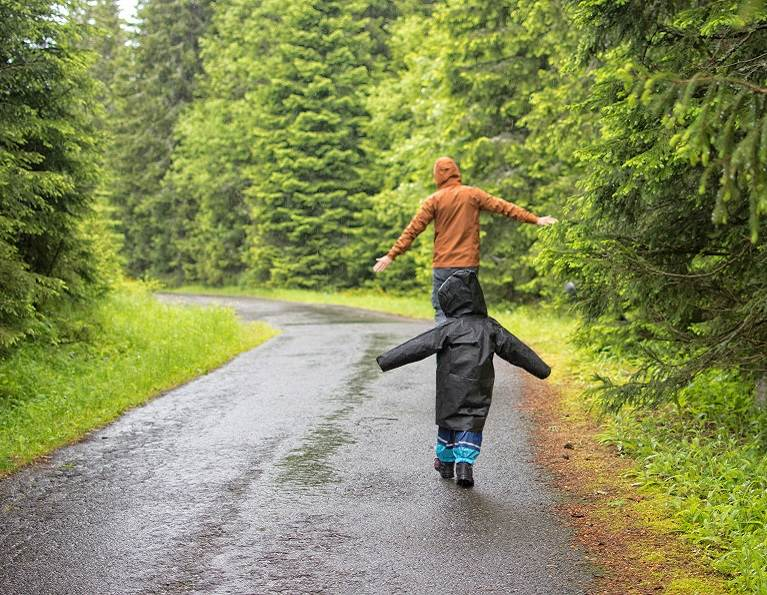 Father and son going for a walk in their rain gear made possible from H.B. Fuller technical textile adhesives.