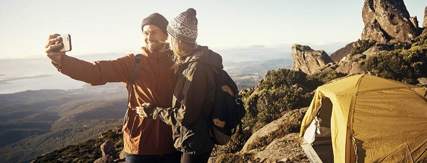 Couple camping on a mountain representing technical textile adhesives from H.B. Fuller.