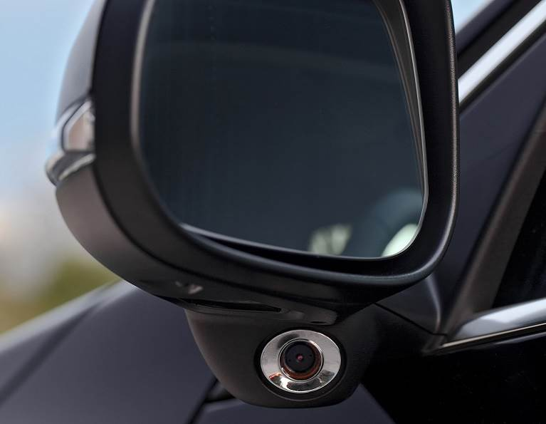 Side camera off of a rear view mirror for automotive electronics.