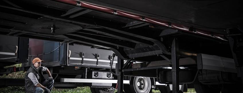 Underbody coatings of a large truck and trailer.