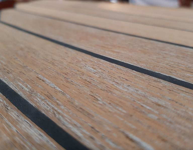 Deck board fastening with adhesive.