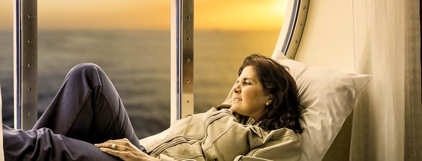 Woman on a large boat looking out the window.