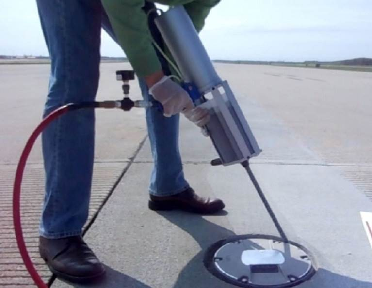 Installing concrete sealant for roadway and runway repair needs.