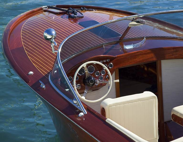 Beautiful boat with woodworking throughout representing wood paneling adhesives for transportation from H.B. Fuller.