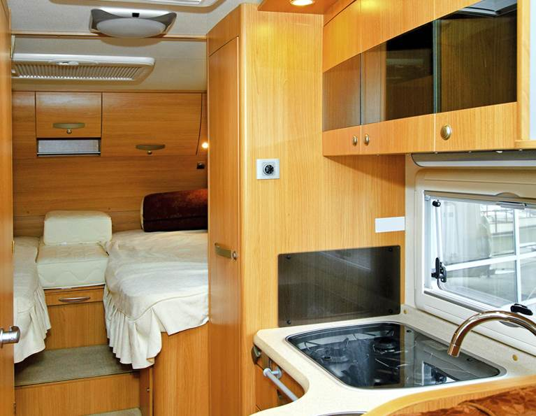 Interior of a camper with wood paneling