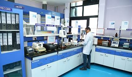 Scientist working in H.B. Fuller Research and Development Lab in India