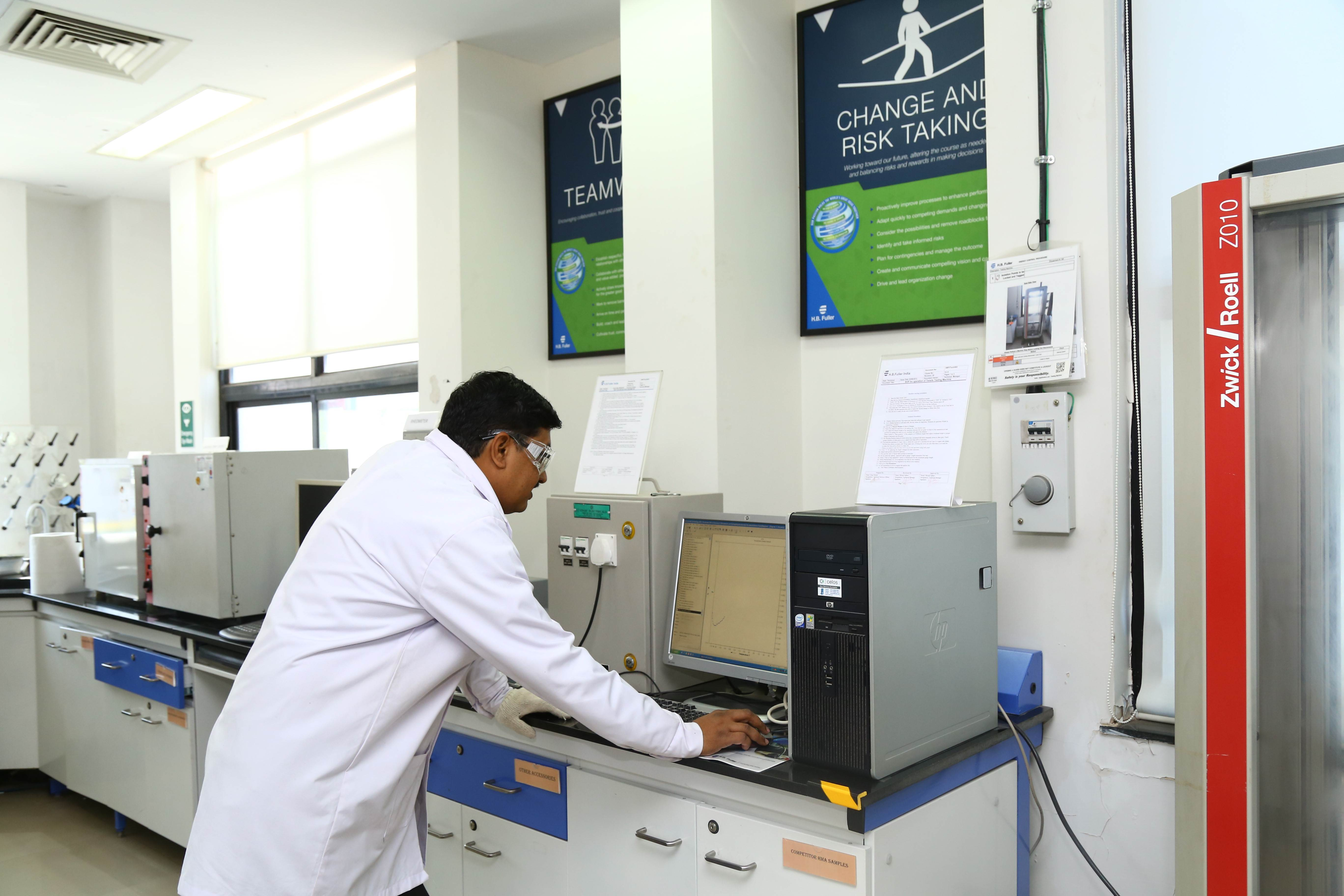 A scientist working in H.B. Fuller's lab in Pune, India at their Technology Center of Excellence.